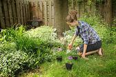 Teenager gardening — Stock Photo