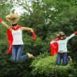 Super heros team jumping - Stock Photo