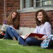 Student sit on a grass — Stock Photo