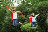 Super heros team jumping — Stock Photo