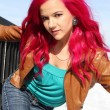 Confident girl with pink hair — Stock Photo
