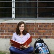Stock Photo: GIrl studying outside