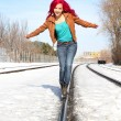 Girl walking on rail — Stock Photo