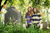 Girls at the cemetery — Stock Photo