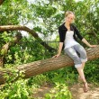 Teen sit on a branch — Stock Photo