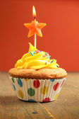 Cupcake with star candle — Stock Photo