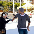 Young Couple Ice Skating Together And Having Fun — Stock Photo