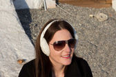 Woman With White Ear Muffs And Sunglasses — Stock Photo
