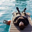 Stock Photo: WomLying On Pier
