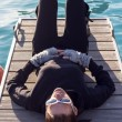 Woman Lying On A Pier - Stock Photo