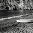 An Old White Boat On A Beach In France in Black & White - Stock Photo