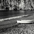 Stock Photo: Old White Boat On Beach In France in Black & White