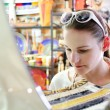 Young Pale Woman Shopping for a Serving Plate — Stock Photo