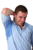 Man sweating very badly under armpit — Stock Photo