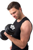 Attractive Young man working out with weights — Stockfoto