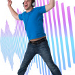 Young Man Listening to music and jumping — Stock Photo