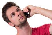 Joven hablando por teléfono — Foto de Stock