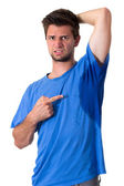 Man sweating very badly under armpit and pointing there — Stockfoto
