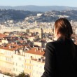 Woman looking down at the City of Nice - Stock Photo