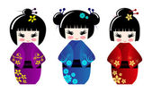 Cute kokeshi dolls — Stock Vector