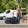 Womdoing hitchhiking — Stock Photo #11347430
