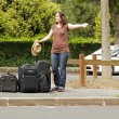 Womdoing hitchhiking — Stock Photo #11400433