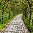 Covered path at Linderhof Castle, South bavaria, Germany - Stock Photo