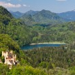 Hohenschwangau Castle and Schwansee lake - Stock Photo