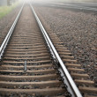 Stock Photo: Railway track in heavy fog