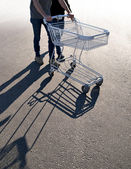 Couple with shopping cart — Stock Photo
