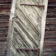 Stock Photo: Uneven old wooden door