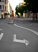 Arrow sign on street — Stock Photo