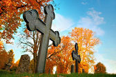 Metal cross on cemetery — Stockfoto