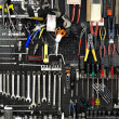 Wall with tools — Stock Photo #11978875