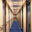Infinite hotel corridor — Stock Photo