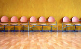Empty pink plastic chairs — Stock Photo