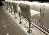 Row of bar stools — Stock Photo