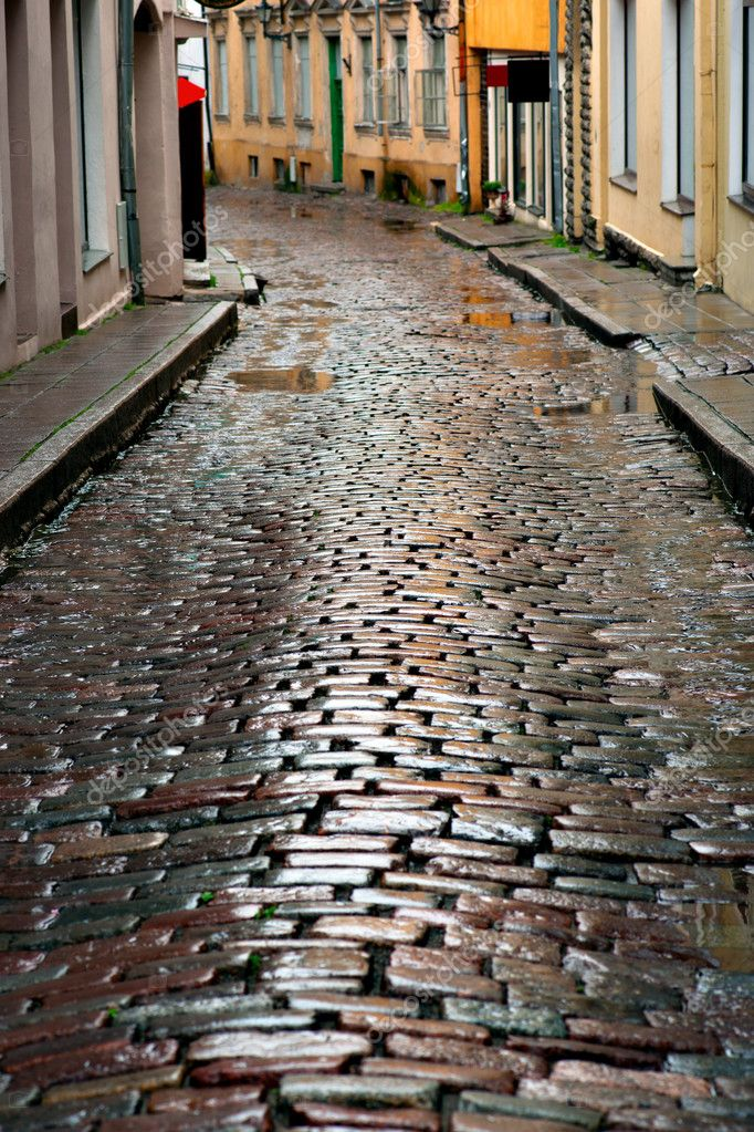 Wet cobblestones after rain on narrow street in the old town of Tallinn, Estonia  Stock Photo #12092370