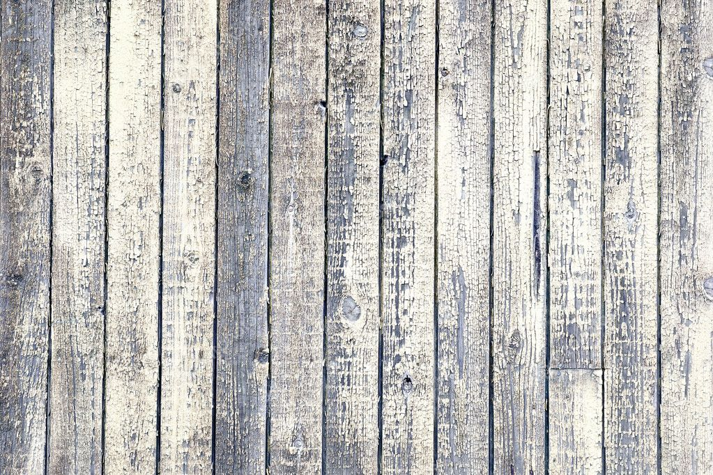 weathered wood with peeling white paint stock photo