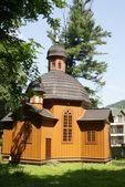 Old wooden catholic church in Krynica resort — Stock Photo