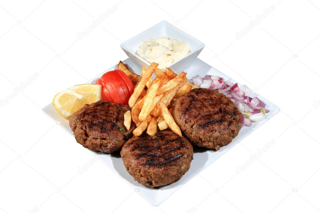 Meat balls served with fried potatoes and vegetables on a plate isolated on a white background  Stock Photo #10917915