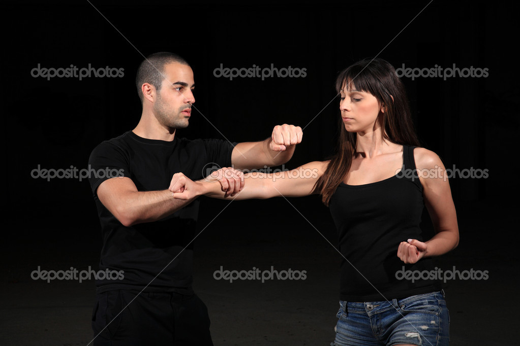 Martial arts instructor exercising with young girl — Stock Photo #10918254