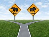 Stock Market crossroads With Bull and Bear Signs — Stock Photo