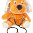 Stock Photo: Teddy bear with stethoscope pediatrician. On white backgroun