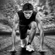 Stock Photo: Creative photo of athletes at start. Black and white.