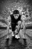 Creative photo of athletes at the start. Black and white. — Stock Photo