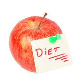 Una manzana con la inscripción - la dieta. sobre un fondo blanco. — Foto de Stock