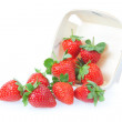 Sprinkled strawberry from the basket. On a white background. — Stock Photo
