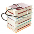 Stock Photo: Stack of books and a stethoscope. On a white background.