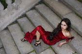 Lady in red dress near private residence — Stock Photo